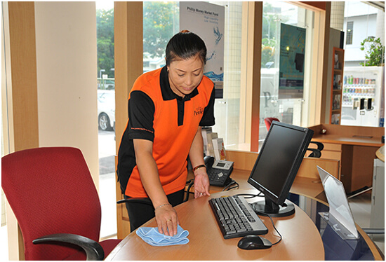 A staff of a Singapore office cleaning company